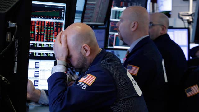 Stocks close in the red as financials fall