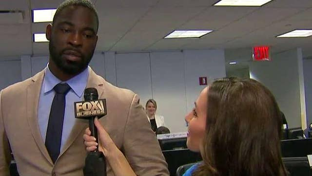 Justin Tuck takes part in BGC Charity Day