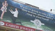 Jeweler accused of racism for 'take a knee' billboard