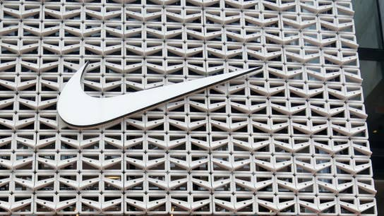 Nike surges on earnings beat after tough market day