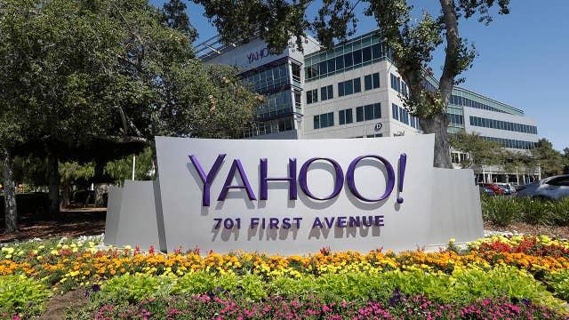Yahoo reaches settlement; McDonald's expands breakfast menu