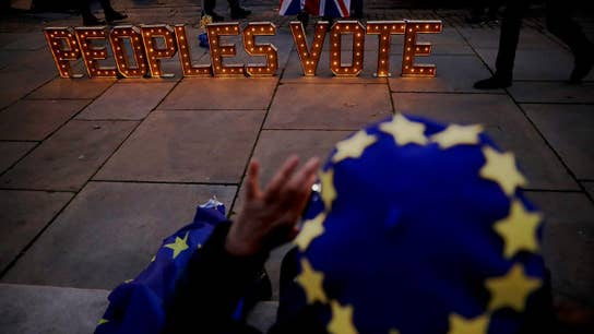 UK's Theresa May delays Brexit vote
