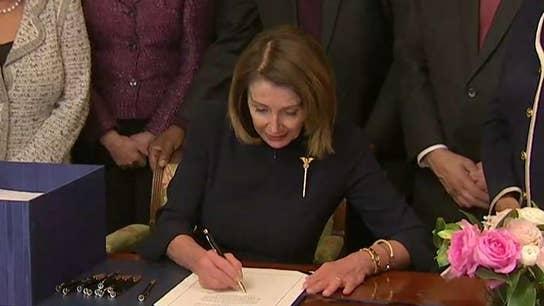 Nancy Pelosi signs spending bill