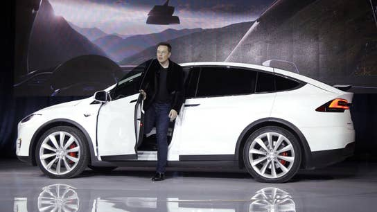 Tesla posts $702M first-quarter loss