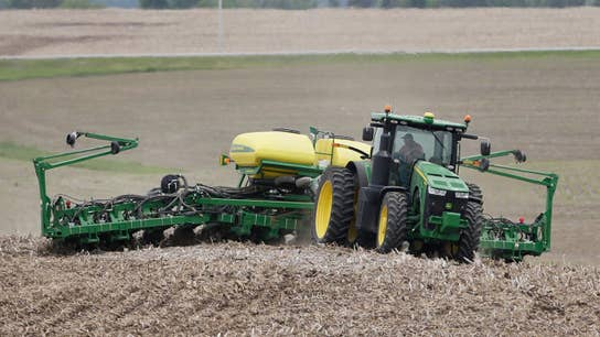 American farmers coping with trade war, severe weather
