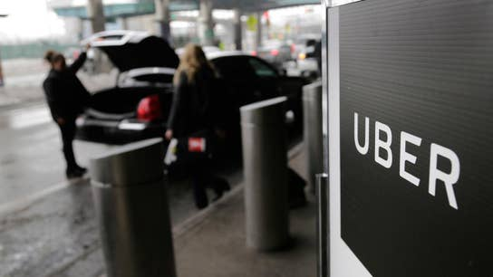 Uber shares open below IPO price of $45
