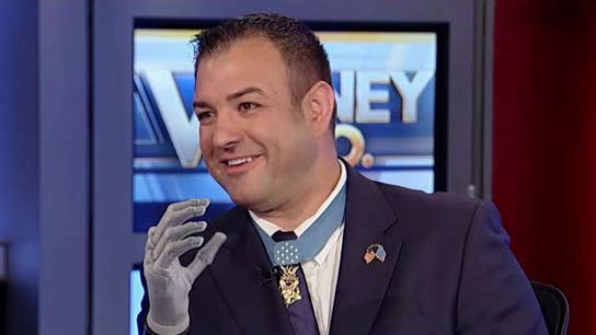 Medal of Honor recipient uses robotic prosthetic hand