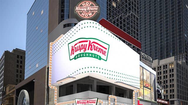 The Dow sees slight gains; Krispy Kreme gives away $1 dozen glazed donuts