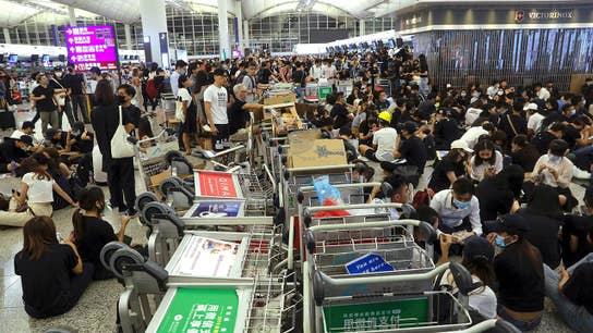 Hong Kong airport protests descend into violence