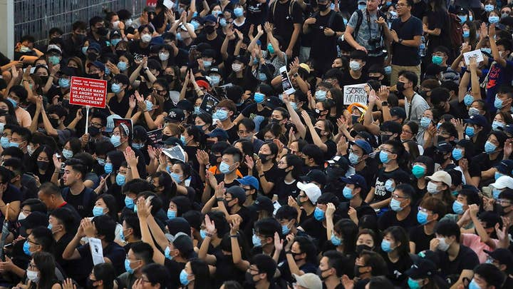 China threatens to use force in Hong Kong