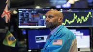 Stocks turning negative on trade uncertainty