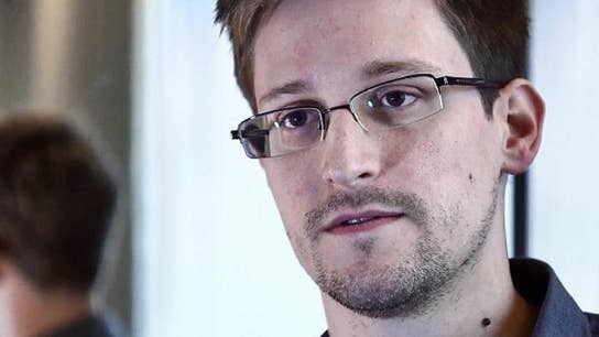 Edward Snowden says he'd return to US if guaranteed 'fair trial'
