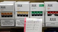Juul suspends popular vaping flavors