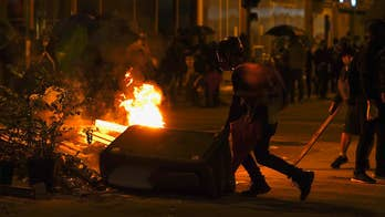 Hong Kong violence continues: Police storm university, threaten to use live rounds