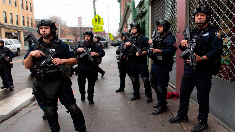 6 killed, including police officer, in Jersey City shooting