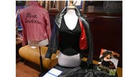 Fan returns Olivia Newton-John's 'Grease' jacket after auction