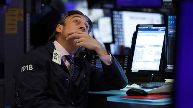 Stocks hit record highs in wake of impeachment