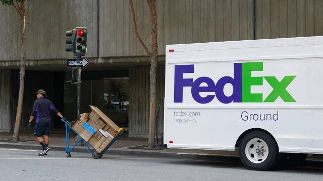 FedEx blames Amazon, shorter shopping season for profit drop
