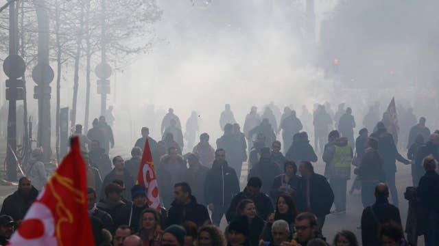 Massive protests rage in France