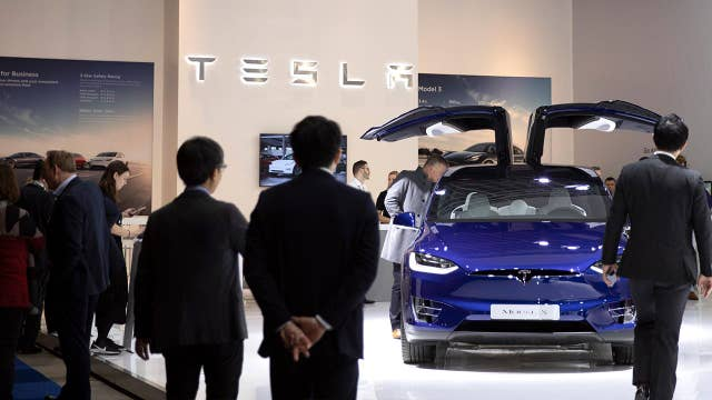 Tesla stock hits all-time high, so how should you invest?
