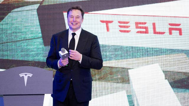 Elon Musk strips on stage at Tesla's Shanghai plant