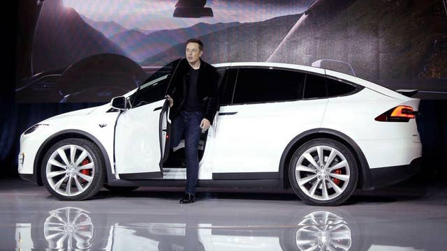 Elon Musk in Shanghai as first foreign-built cars roll off assembly line