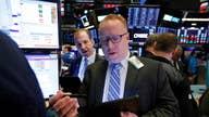 Tesla shares surges above $900