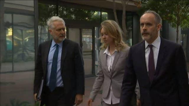 Elizabeth Holmes, Sunny Balwani enter federal court building in California