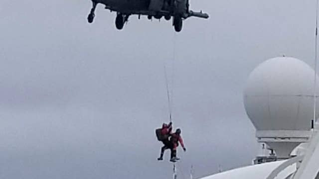 Military helicopter delivers coronavirus test kits to cruise ship