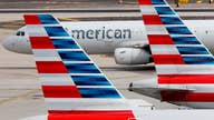American Airlines reportedly slashing international flights; Walt Disney to furlough non-essential workers
