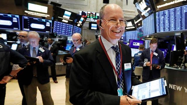 Stocks climb on Fed stimulus news