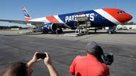 Patriots' plane brings 1.2M coronavirus masks from China to US