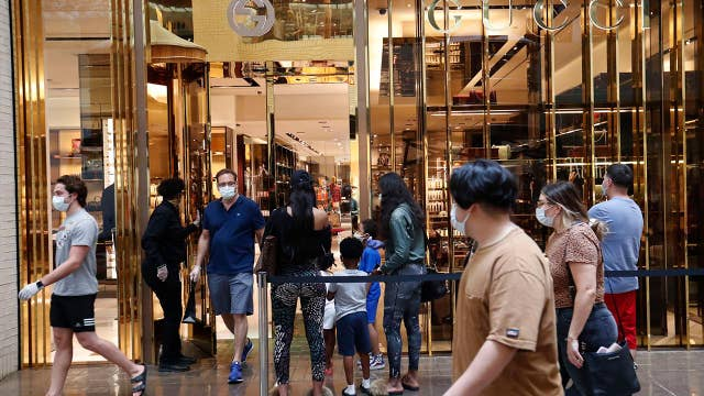 Steady stream of shoppers flock to Indiana mall after coronavirus restrictions ease