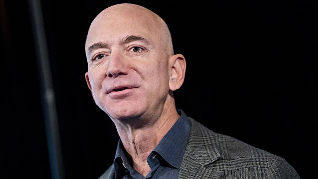 Protesters outside Amazon's Jeff Bezos' home set up guillotine