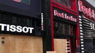 New York City retailers board up, gut stores to stop looters