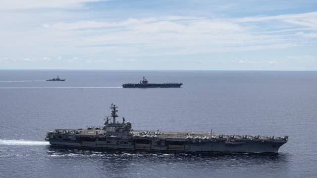 US aircraft carriers return to contested South China Sea