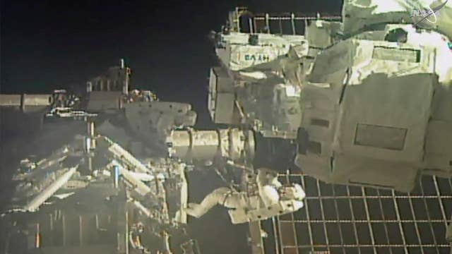 NASA astronauts conduct spacewalk outside of ISS