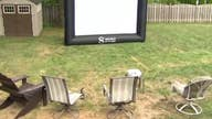 People elevating their at-home entertainment by building a backyard big screen