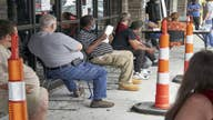 US economy adds 1.8M jobs in July