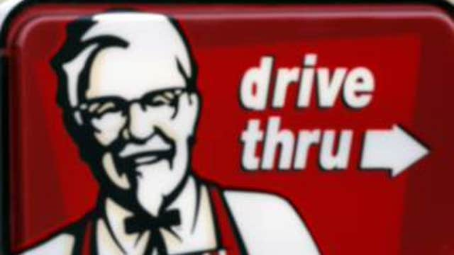 FBN's Lauren Simonetti breaks down Yum Brands' third-quarter earnings report and previews Alcoa's third-quarter earnings estimates.