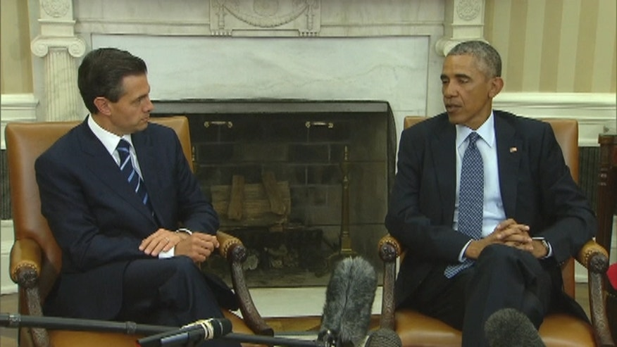 Mexican President Enrique Peña Nieto and President Barack Obama speak to the press after their White House meeting.