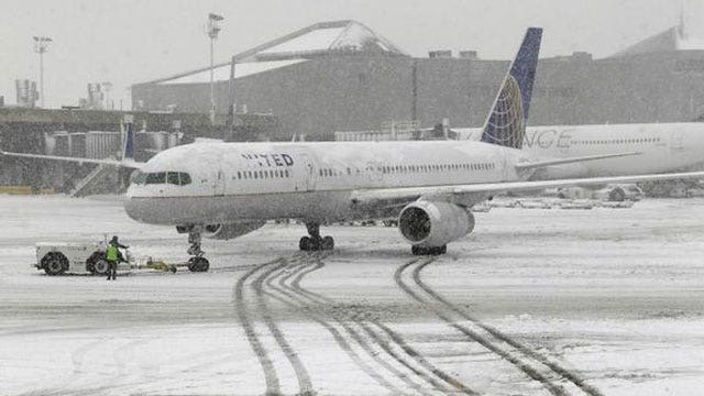 Airlines cancel thousands of flights as storm moves in