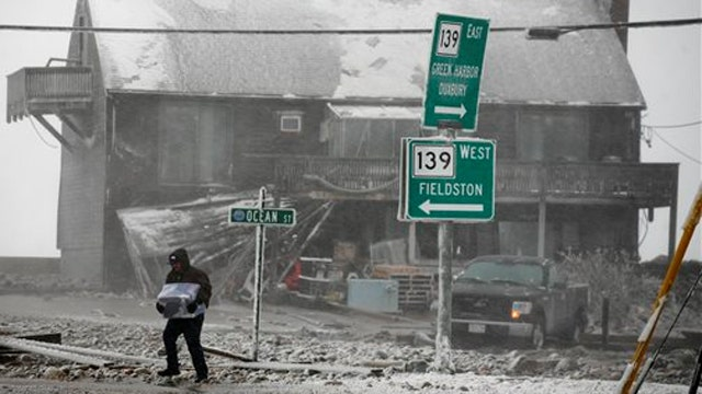Blizzard breaches seawall in Mass. flooding neighborhood