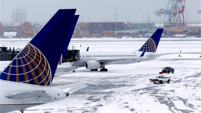 Airlines struggle to resume normal schedules after blizzard