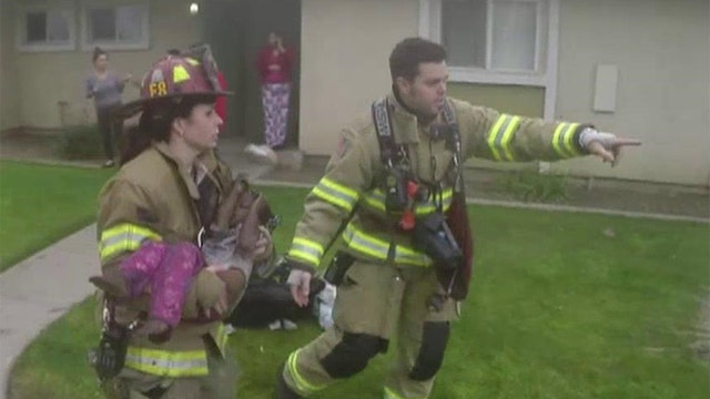 Firefighters rescue three children trapped in apartment fire