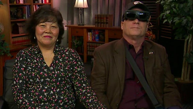 Blinded soldier sees wife first time in 20 years