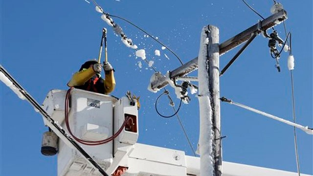 Crews in New England work to restore power after blizzard