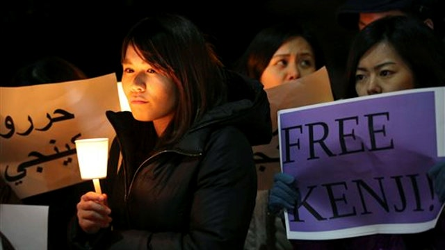 Crowds in Jordan, Japan call for hostages' release
