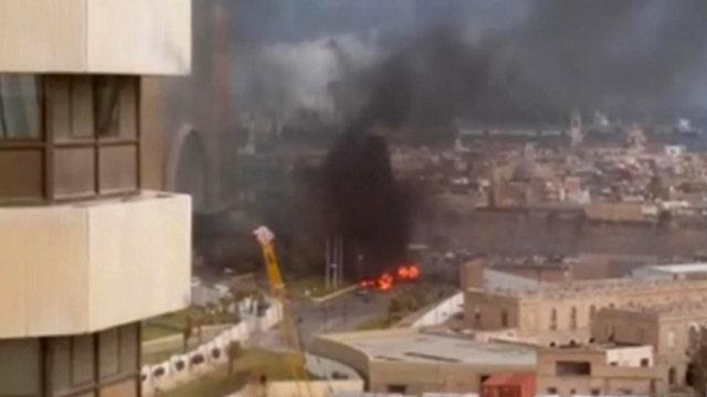 Masked gunmen storm luxury hotel in Libya