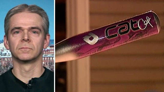 Father fights off escaped prisoner with bat